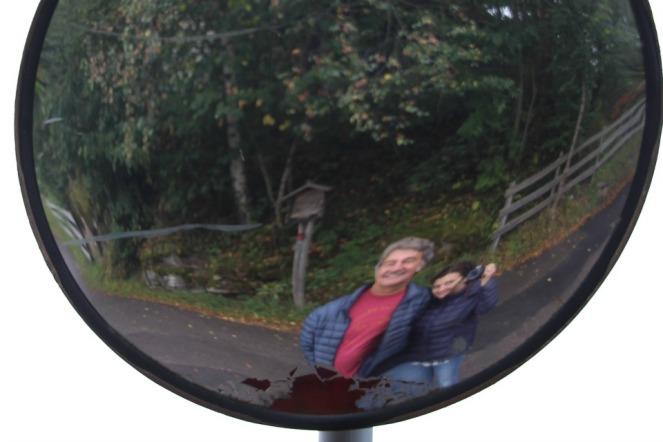 Dan and Rudi in the traffic mirror in Italy